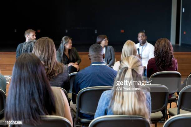 rear view photo of audience listening to panel presentation - panel discussion stock pictures, royalty-free photos & images