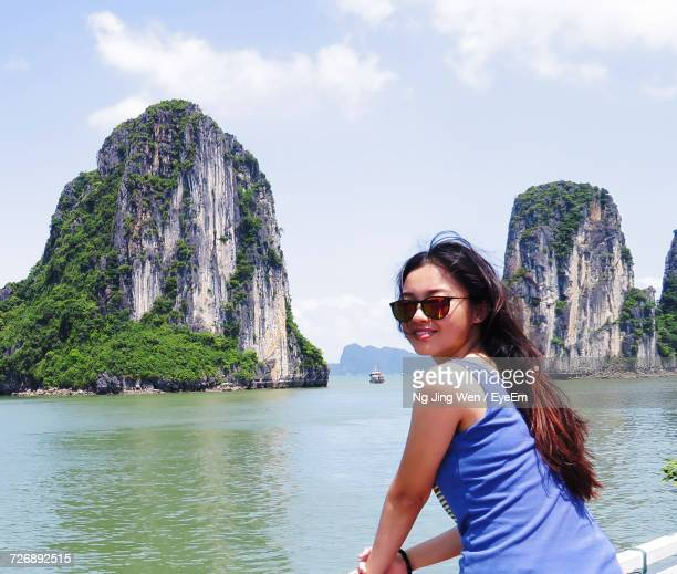 Rear View Portrait Of Woman Standing On Boat At Halong Bay