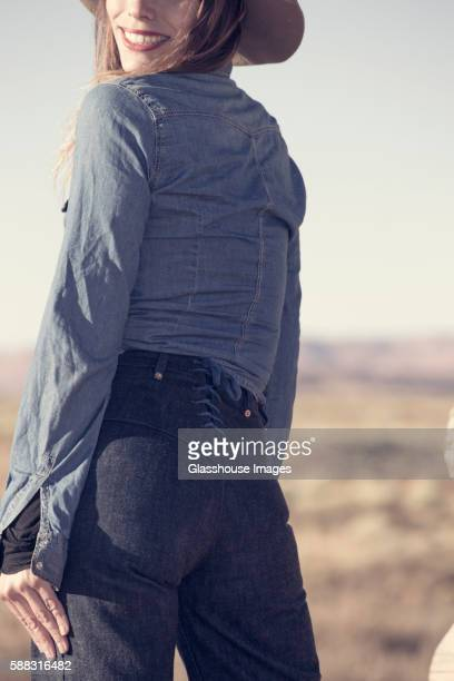 Rear View Portrait of Woman Wearing Vintage Denim Shirt and Lace-Up Jeans