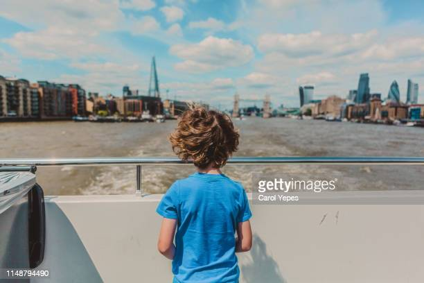 rear view tourist boy traveling by boat in river thames - nautical vessel stock pictures, royalty-free photos & images
