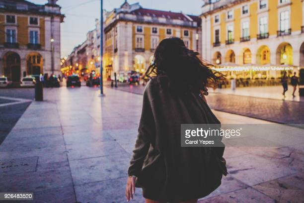rear view woman walking in the night,lisbon,portugal - one young woman only stock pictures, royalty-free photos & images
