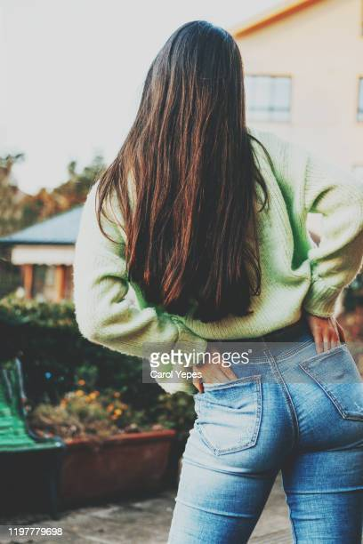 rear view young teen in blue jeans. - woman bum stock pictures, royalty-free photos & images