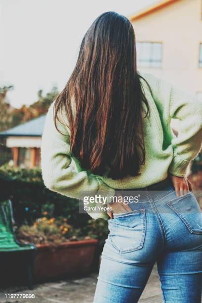 rear view young teen in blue jeans. - cadera mujer fotografías e imágenes de stock