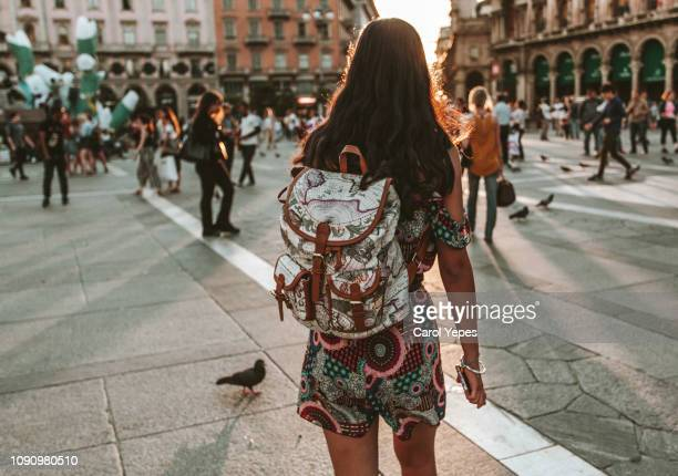rear view young woman with backpack walking in duomo piazza,italy - milan stock pictures, royalty-free photos & images
