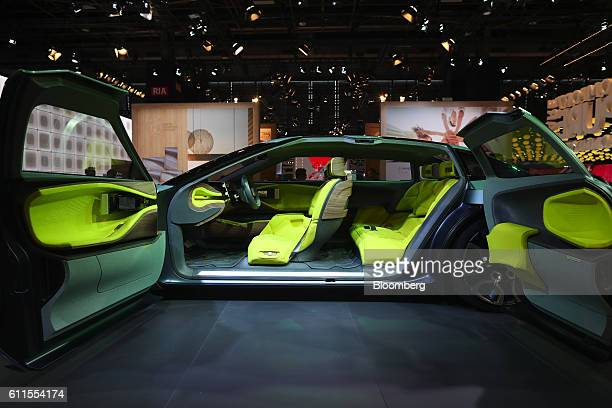 Rear-hinged doors sit open on a new Citroen Cxperience concept automobile, manufactured by the PSA Group, during the second press day of the Paris...