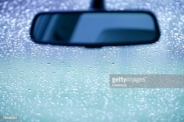 Rearview mirror and rain on a windshield
