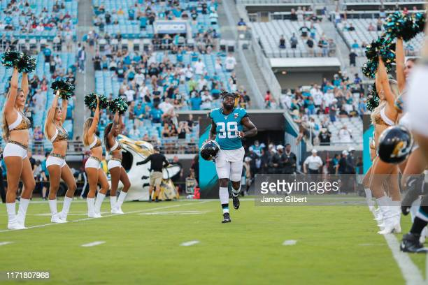 J Reavis of the Jacksonville Jaguars enters the field before the start of a preseason game against the Atlanta Falcons at TIAA Bank Field on August...