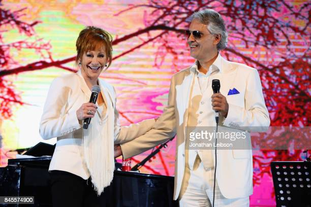Reba McEntire and Andrea Bocelli perform during the Closing Night Gala at Cinecittà as part of the 2017 Celebrity Fight Night in Italy Benefiting The...