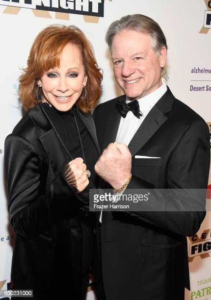 Reba McEntire and Anthony Lasuzzo attend Celebrity Fight Night XXIV on March 10 2018 in Phoenix Arizona