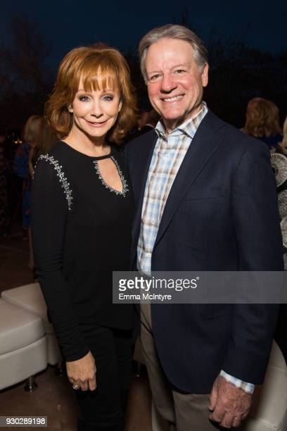 Reba McEntire and Anthony Lasuzzo attend the Celebrity Fight Night's Founders Club Dinner on March 9 2018 in Phoenix Arizona