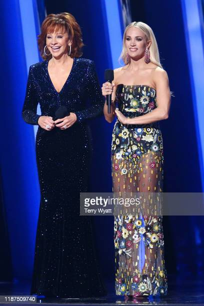 Reba McEntire and Carrie Underwood speak onstage during the 53rd annual CMA Awards at the Bridgestone Arena on November 13, 2019 in Nashville,...