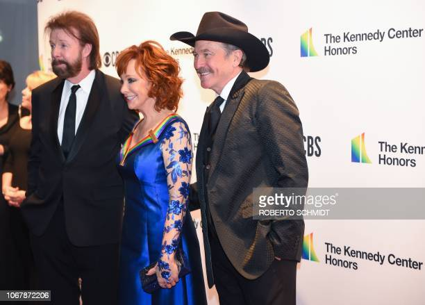 Reba McEntire and Country Music Duo Brooks and Dunn, Ronnie Dunn and Kix Brooks, arrive at the 41st Annual Kennedy Center Honors in Washington, DC,...