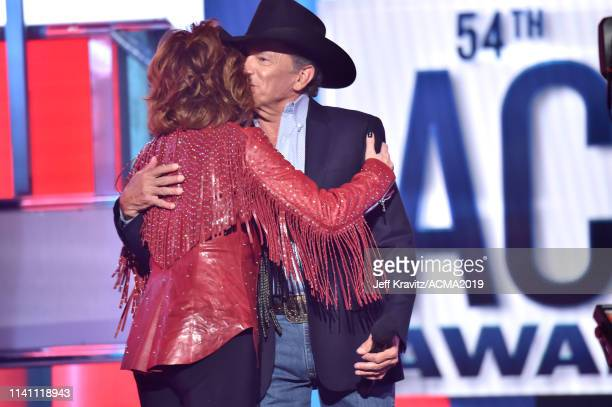 Reba McEntire and George Strait speak onstage during the 54th Academy Of Country Music Awards at MGM Grand Garden Arena on April 07 2019 in Las Vegas...
