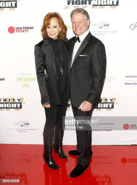 Reba McEntire and guest arrive to Celebrity Fight Night XXIV held at JW Marriot Desert Ridge Resort Spa on March 10 2018 in Phoenix Arizona