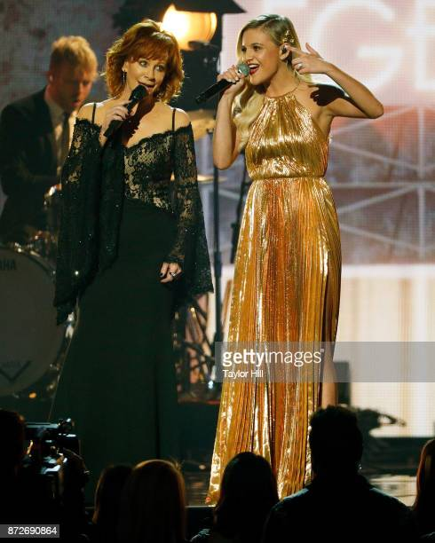 Reba McEntire and Kelsea Ballerini perform during the 51st annual CMA Awards at the Bridgestone Arena on November 8 2017 in Nashville Tennessee
