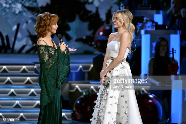 Reba McEntire and Kelsea Ballerini performs onstage for CMA 2017 Country Christmas at The Grand Ole Opry on November 14 2017 in Nashville Tennessee