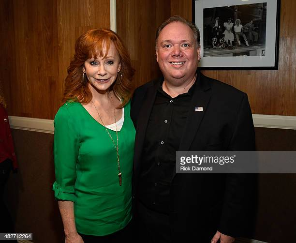 Reba McEntire and Kirt Webster Webster PR backstage during Dolly Parton Pure Simple Benefiting The Opry Trust Fund at Ryman Auditorium on August 1...