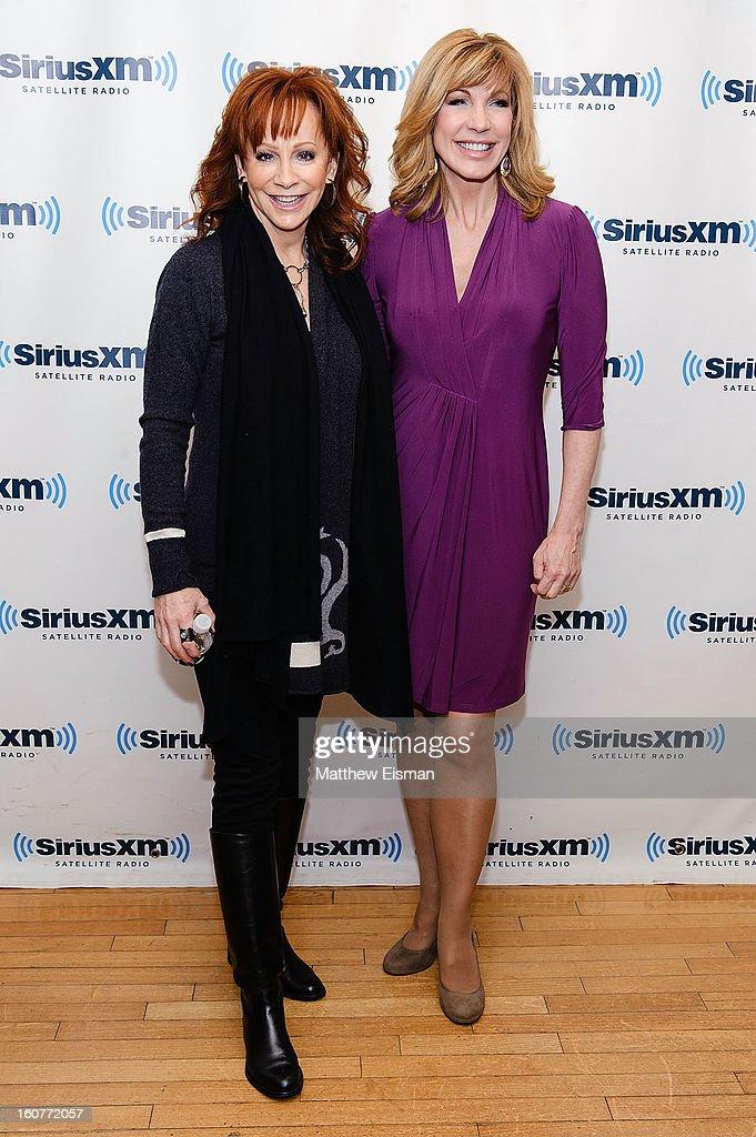 Reba McEntire (L) and Leeza Gibbons visit SiriusXM Studios on February 5, 2013 in New York City.