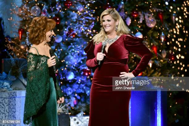 Reba McEntire and Trisha Yearwood perform onstage for CMA 2017 Country Christmas at The Grand Ole Opry on November 14 2017 in Nashville Tennessee