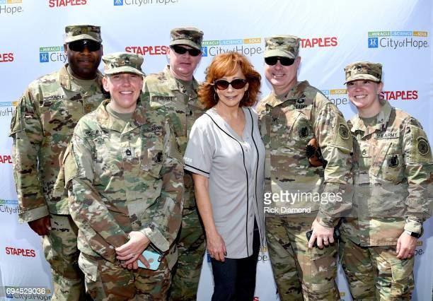 Reba McEntire and US Troops arrive at the 27th Annual City of Hope Celebrity Softball Game at First Tennessee Park on June 10, 2017 in Nashville,...