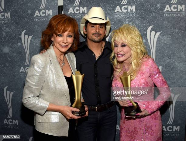 Reba McEntire Brad Paisley and Dolly Parton attend the 11th Annual ACM Honors at the Ryman Auditorium on August 23 2017 in Nashville Tennessee