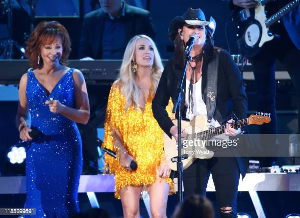 Reba McEntire Carrie Underwood and Terri Clark perform performs onstage during the 53rd annual CMA Awards at the Bridgestone Arena on November 13...