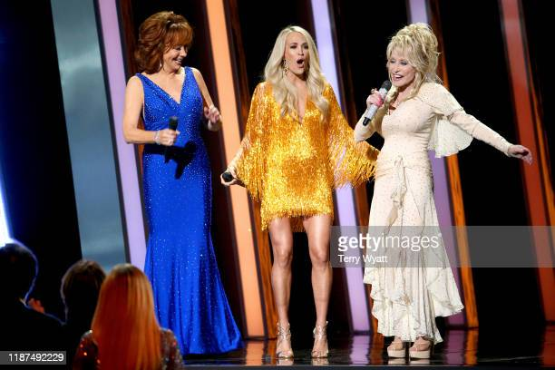 Reba McEntire, Carrie Underwood, Dolly Parton perform onstage during the 53rd annual CMA Awards at the Music City Center on November 13, 2019 in...