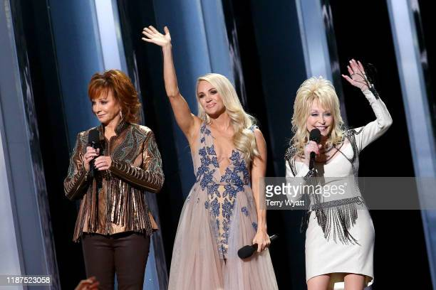 Reba McEntire, Carrie Underwood, Dolly Parton speak onstage during the 53rd annual CMA Awards at the Music City Center on November 13, 2019 in...
