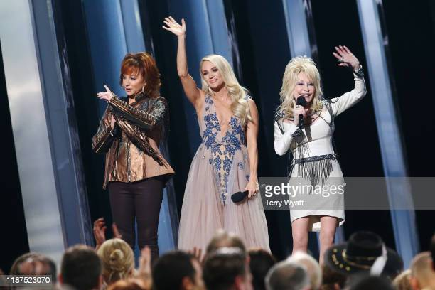 Reba McEntire Carrie Underwood Dolly Parton speak onstage during the 53rd annual CMA Awards at the Music City Center on November 13 2019 in Nashville...