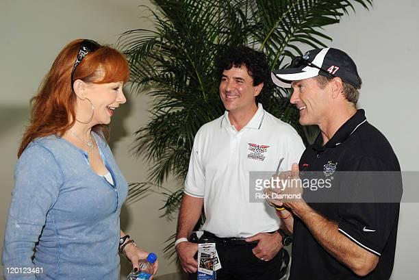 Reba McEntire CEO and President of Big Machine Records Scott Borchetta and NASCAR driver Bobby Labonte arrive for the Brickyard 400 Qualifying...