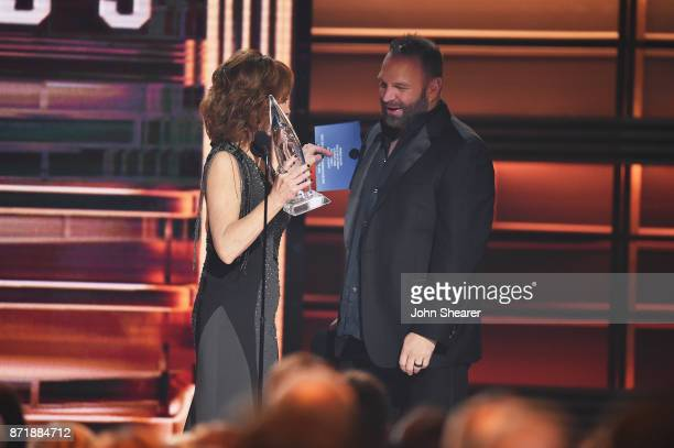Reba McEntire gives Entertainer of the year award to Garth Brooks onstage at the 51st annual CMA Awards at the Bridgestone Arena on November 8 2017...