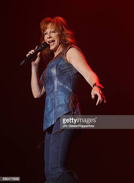 Reba McEntire performing on stage during the International Festival of Country Music at Wembley Arena in London on the 26th February, 2012.