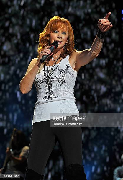 Reba McEntire performs at LP Field during the 2010 CMA Music Festival on June 11 2010 in Nashville Tennessee