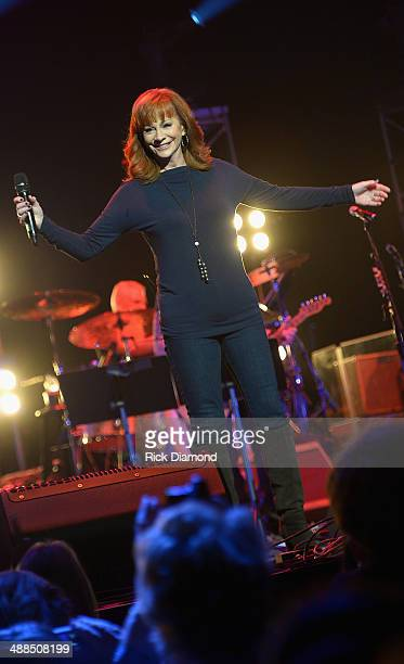 Reba McEntire performs on stage during Keith Urban's Fifth Annual We're All 4 The Hall Benefit Concert at the Bridgestone Arena on May 6 2014 in...