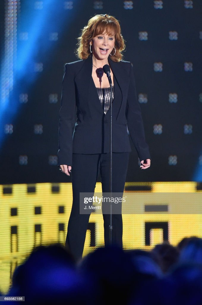 Reba McEntire presents an award onstage from at the 2017 CMT Music Awards at the Music City Center on June 7, 2017 in Nashville, Tennessee.