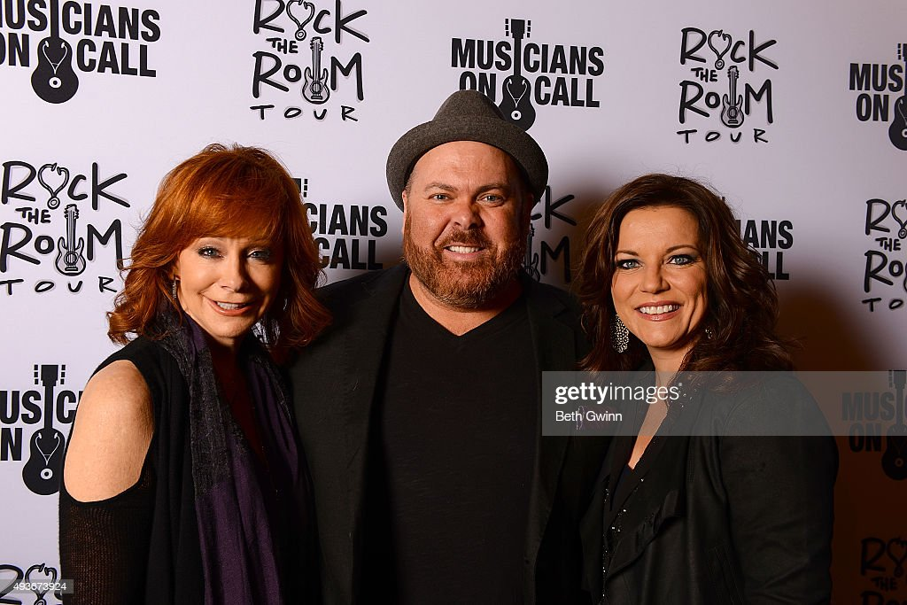 Reba McEntire, Shane Tarleton, and Martina McBride on the red carpet at the Musicians on Call event at City Winery Nashville on October 21, 2015 in Nashville, Tennessee.