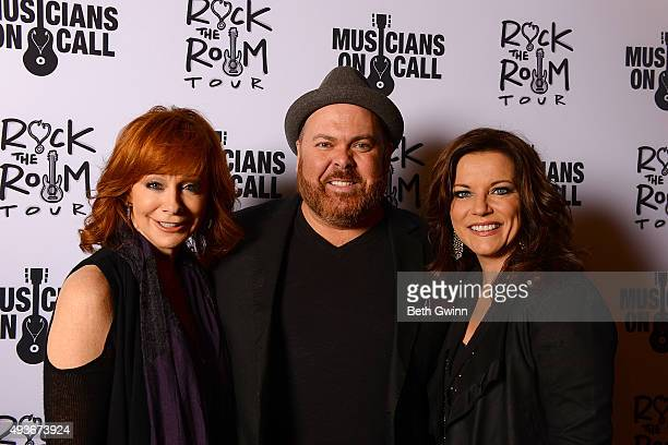 Reba McEntire Shane Tarleton and Martina McBride on the red carpet at the Musicians on Call event at City Winery Nashville on October 21 2015 in...