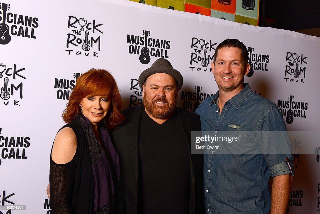 Reba McEntire, Shane Tarleton, and Peter Griffin on the red carpet before the Musicians on Call event at City Winery Nashville on October 21, 2015 in Nashville, Tennessee.