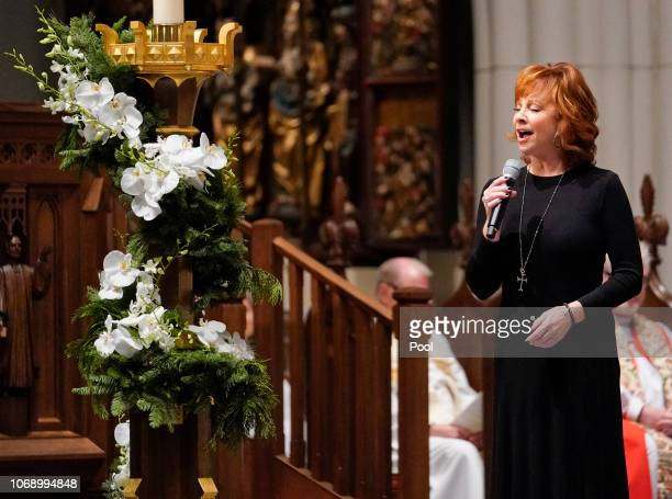 Reba McEntire sings The Lord's Prayer during a funeral service for former President George HW Bush at St Martins Episcopal Church on December 6 2018...