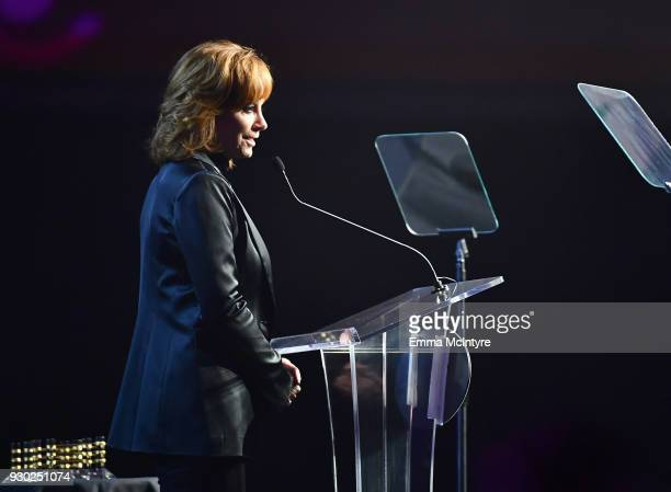 Reba McEntire speaks onstage at Celebrity Fight Night XXIV on March 10 2018 in Phoenix Arizona
