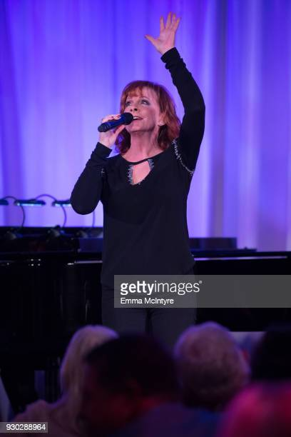 Reba McEntire speaks onstage at the Celebrity Fight Night's Founders Club Dinner on March 9 2018 in Phoenix Arizona