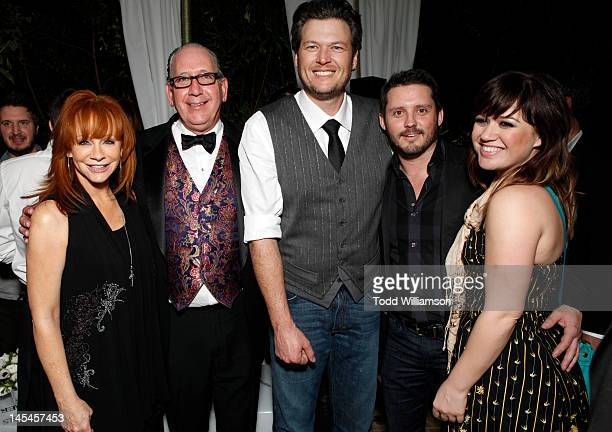 Reba McEntire Warner Music Nashville's President and CEO John Espositio Blake Shelton Brandon Blackstock and Kelly Clarkson attend Warner Music Group...