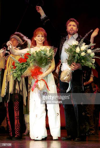 Reba McEntire waves to the audiance after making her Broadway debut as Annie Oakley in the Tony Award winning musical 'Annie Get Your Gun' January 26...