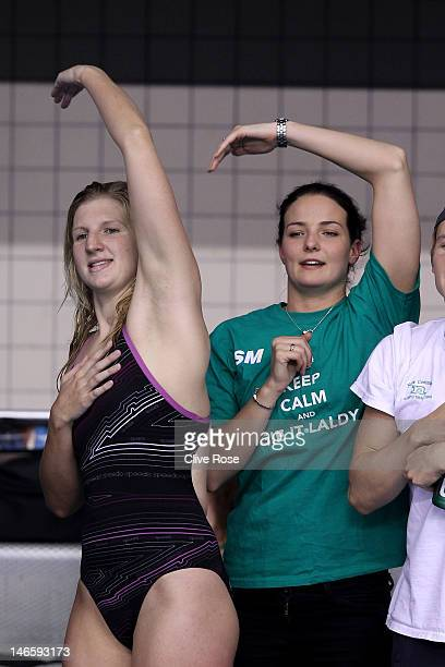 Rebecca Adlington and KeriAnne Payne cheer on David Carry during the Men's 400m Freestyle final during the British Gas ASA National Championships at...