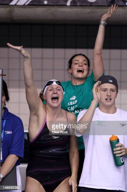 Rebecca Adlington KeriAnne Payne and Harry Needs cheer on David Carry during the Men's 400m Freestyle final during the British Gas ASA National...