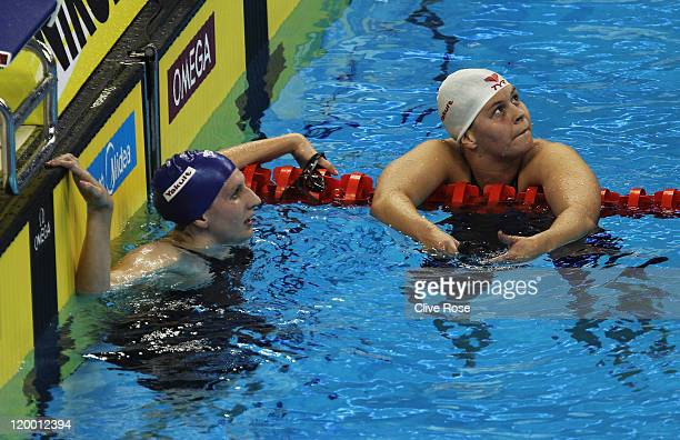 Rebecca Adlington of Great Britain and Lotte Friis of Denmark look on after they swam in heat five of the Women's 800m Freestyle heats during Day...