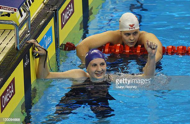 Rebecca Adlington of Great Britain celebrates winning the gold medal with silver medalist Lotte Friis of Denmark in the Women's 800m Freestyle Final...