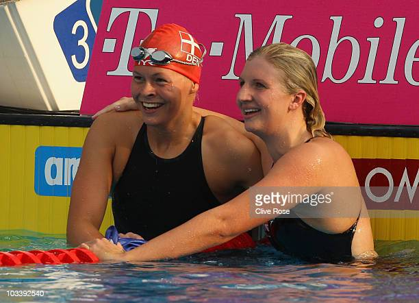 Rebecca Adlington of Great Britain celebrates with Lotte Friis of Denmark after winning the Women's 400m Freestyle Final during the European Swimming...