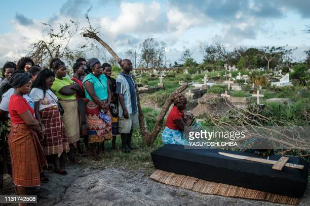 TOPSHOT Rebecca Albino a mother of three children mourns beside the coffin of her husband Tomas Joaquim Chimukme during his funeral following a...