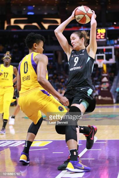 Rebecca Allen of the New York Liberty handles the ball against Alana Beard of the Los Angeles Sparks during a WNBA basketball game at Staples Center...